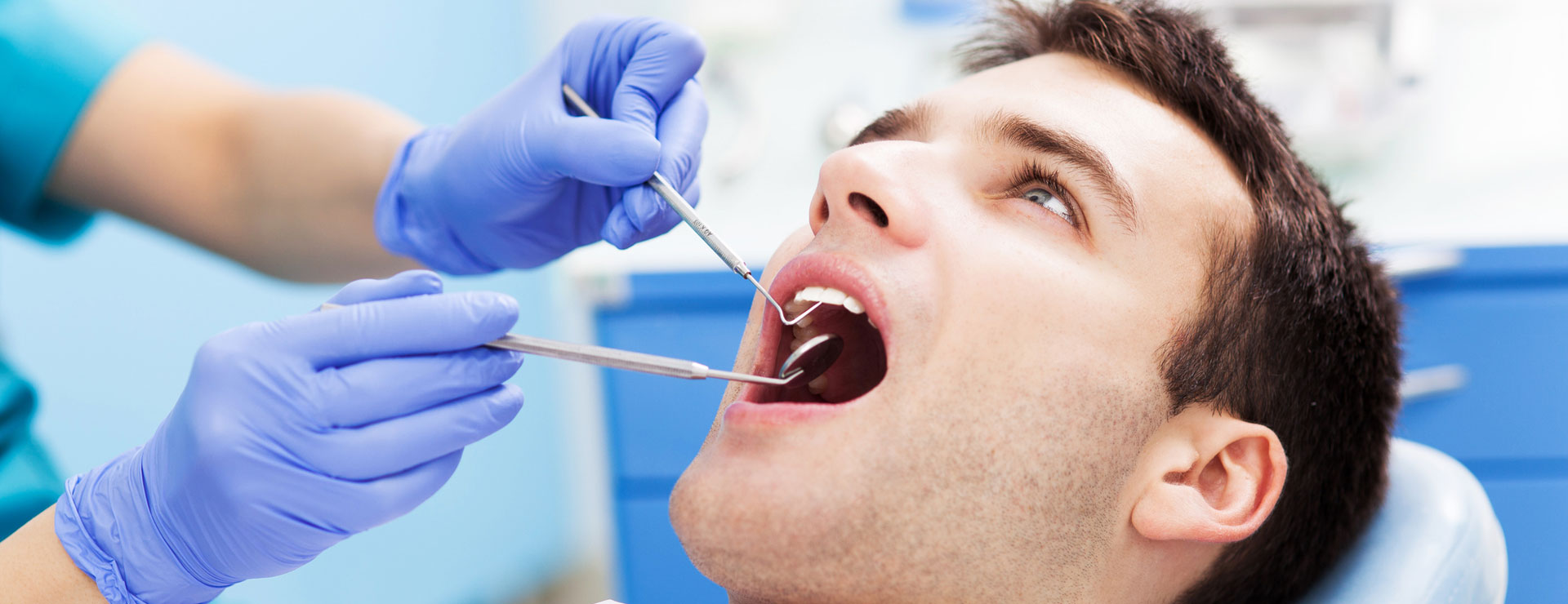 A patient getting a check up on oral cancer