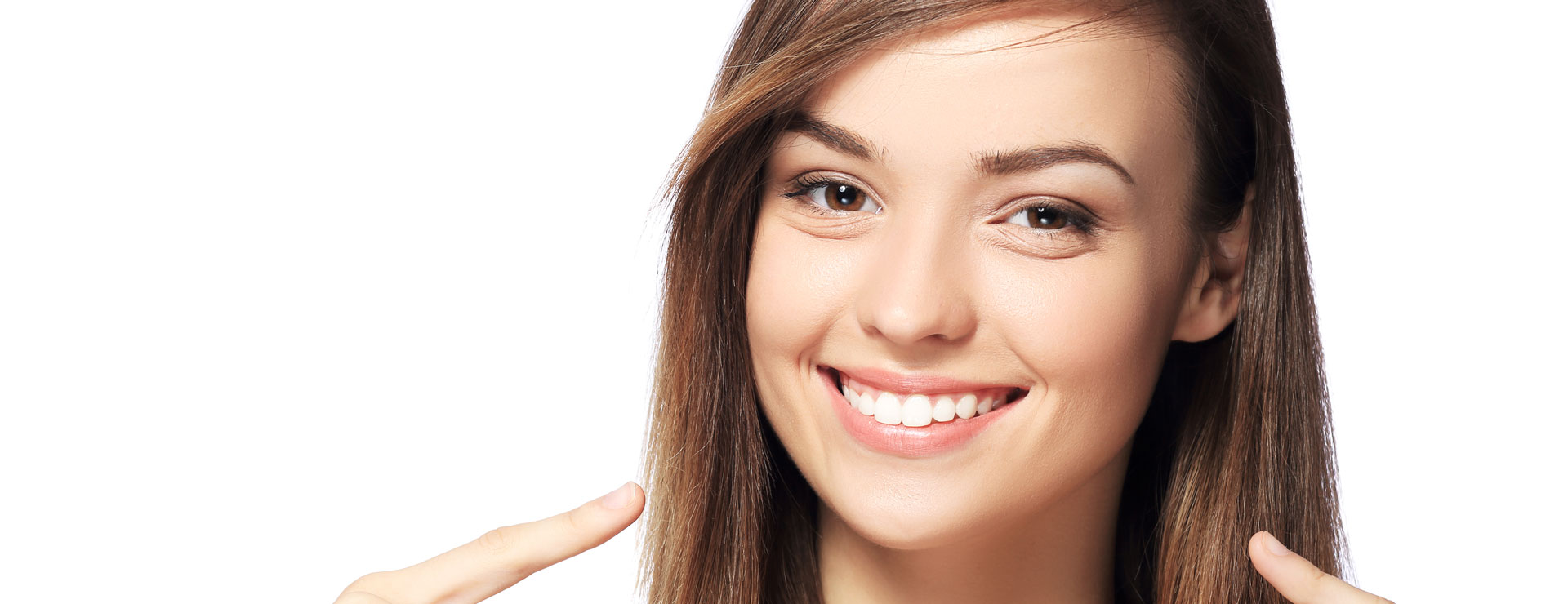 Happy girl pointing at her teeth after smile makeover