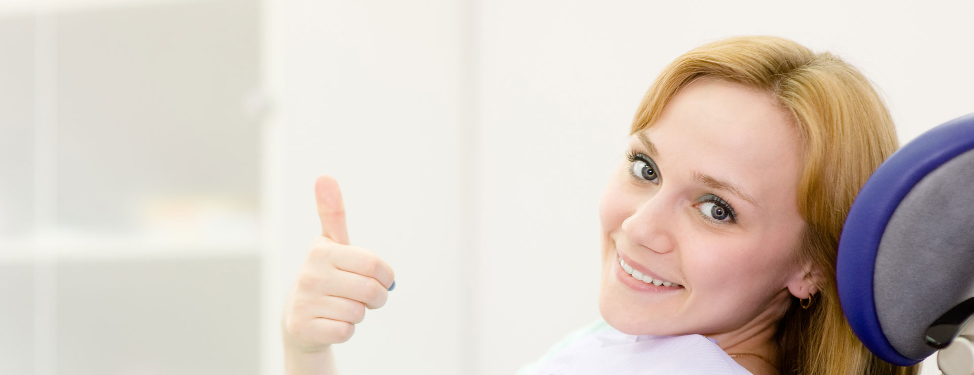 A patient giving a thumbs up to teeth whitening at Todd S. Adams DDS