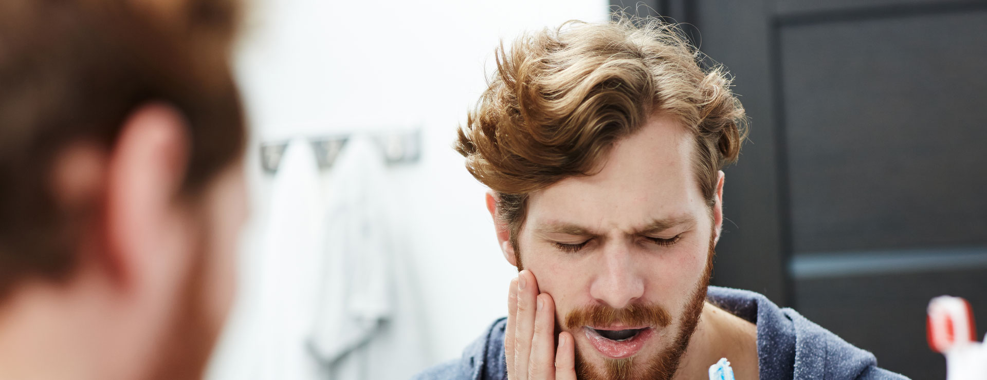 A person who is having TMJ pain